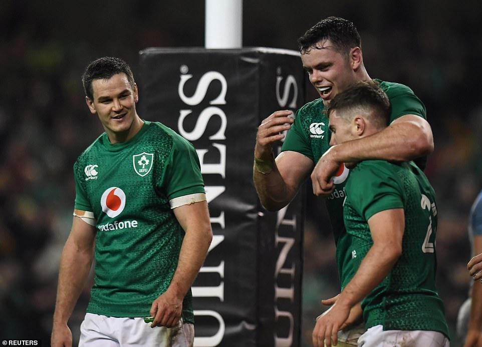 Jonathan Sexton (left) and James Ryan congratulate Luke McGrath after scoring Ireland's third attempt