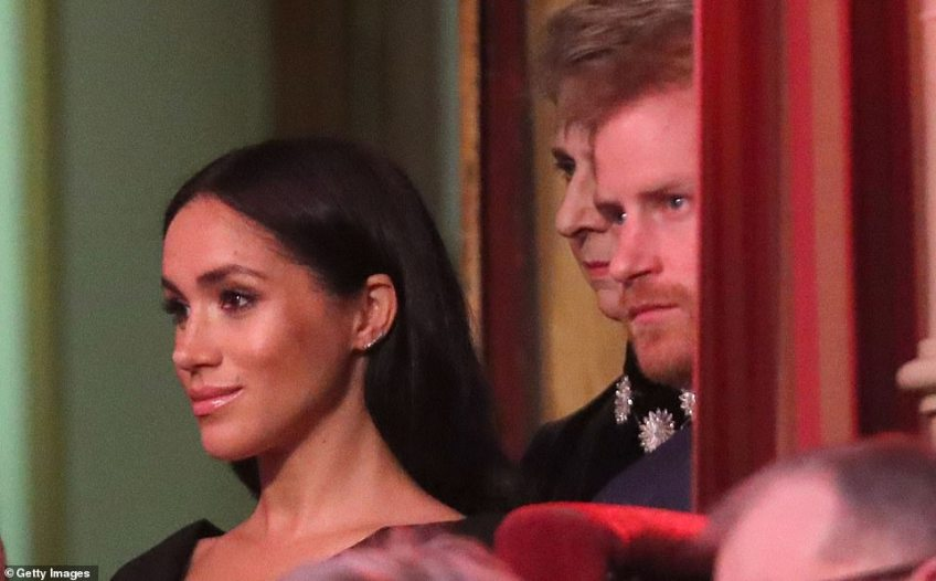 Prince Harry, Duke of Sussex and Meghan, Duchess of Sussex take their seats inside the Royal Albert Hall