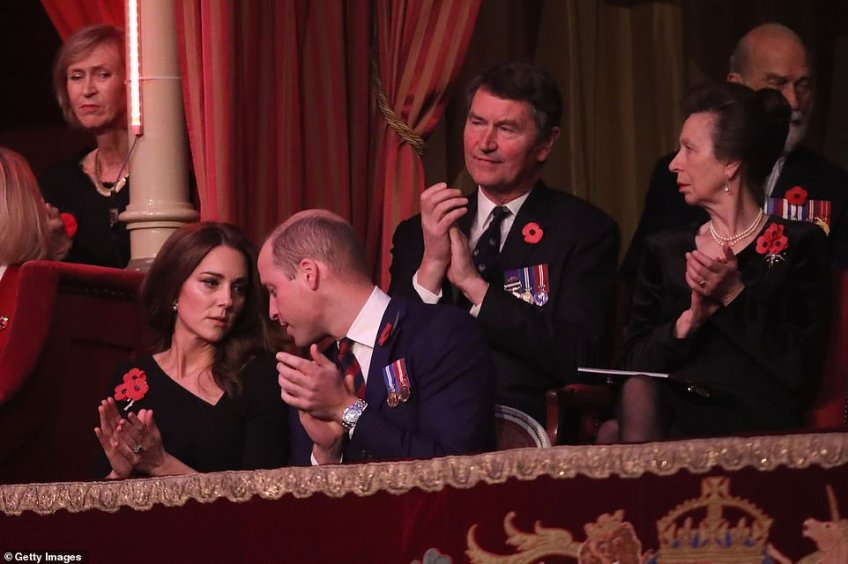 Prince William, Duke of Cambridge, Catherine, Duchess of Cambridge, Princess Anne, Princess Royal and Vice Admiral Sir Tim Laurence sit together tonight inside the Royal Albert Hall