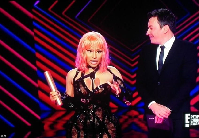 Candid: During Nicki Minaj's acceptance speech for Album Of The Year for Queen, the rapper thanked God, her fans and voters; she also jokingly gave a shout out to 'Kim Kardashian's a** in that dress'