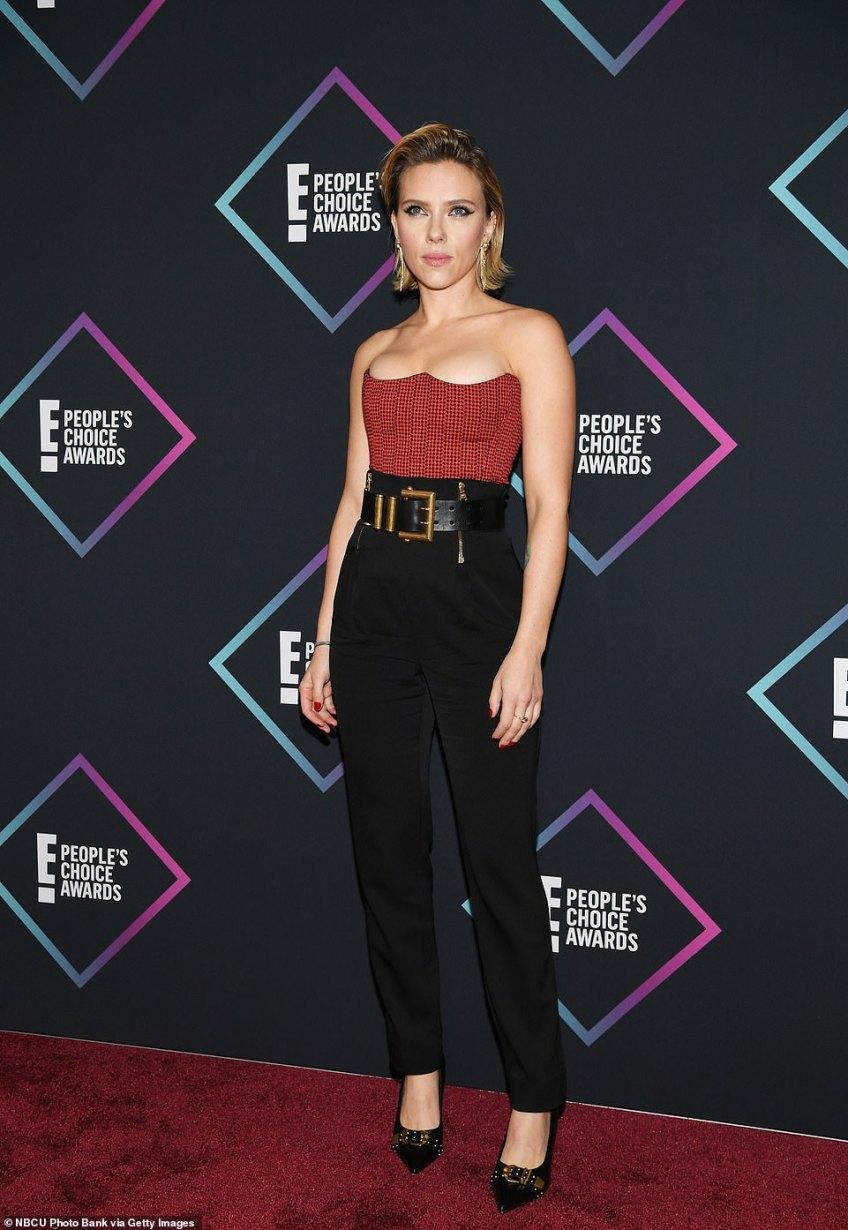 Movie star: Scarlett Johansson cut an elegant figure in high-waisted trousers with a chunky belt and a strapless bodysuit