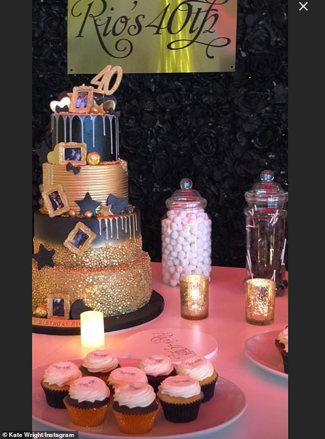 Let them eat cake: She treated him to a four-tier gold cake covered with pictures of the couple