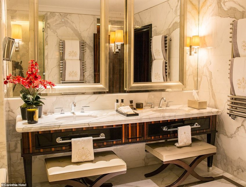 Each of the four bedrooms has been individually designed, with this bathroom coming with twin sinks and mirrors
