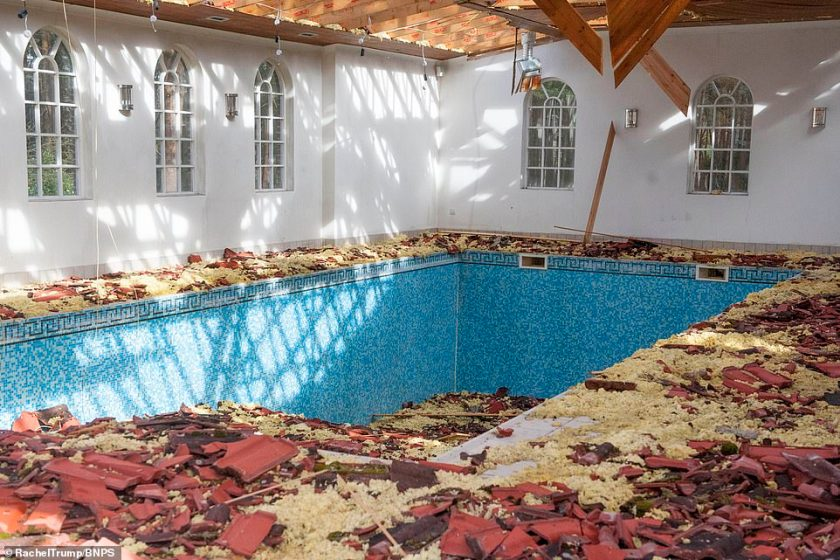 Roof tiles and wood shreddings dominate the space were once people would lounge after a dip in the property's indoor pool