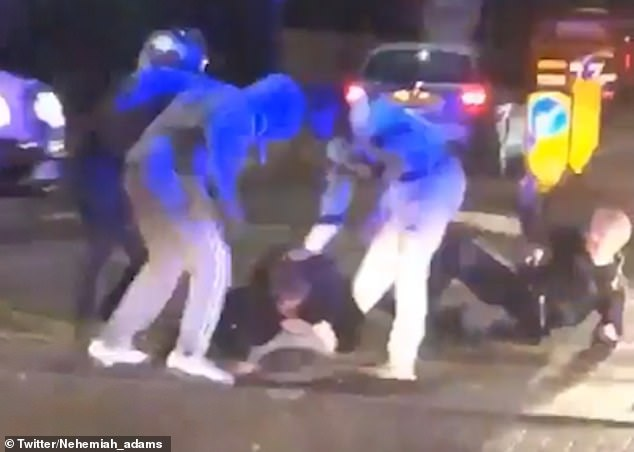 The two men wearing tracksuits and hoodies savagely kicked the two police officers on Saturday night. It was captured on camera and is believed to have taken place in Merton, south west London on Saturday night