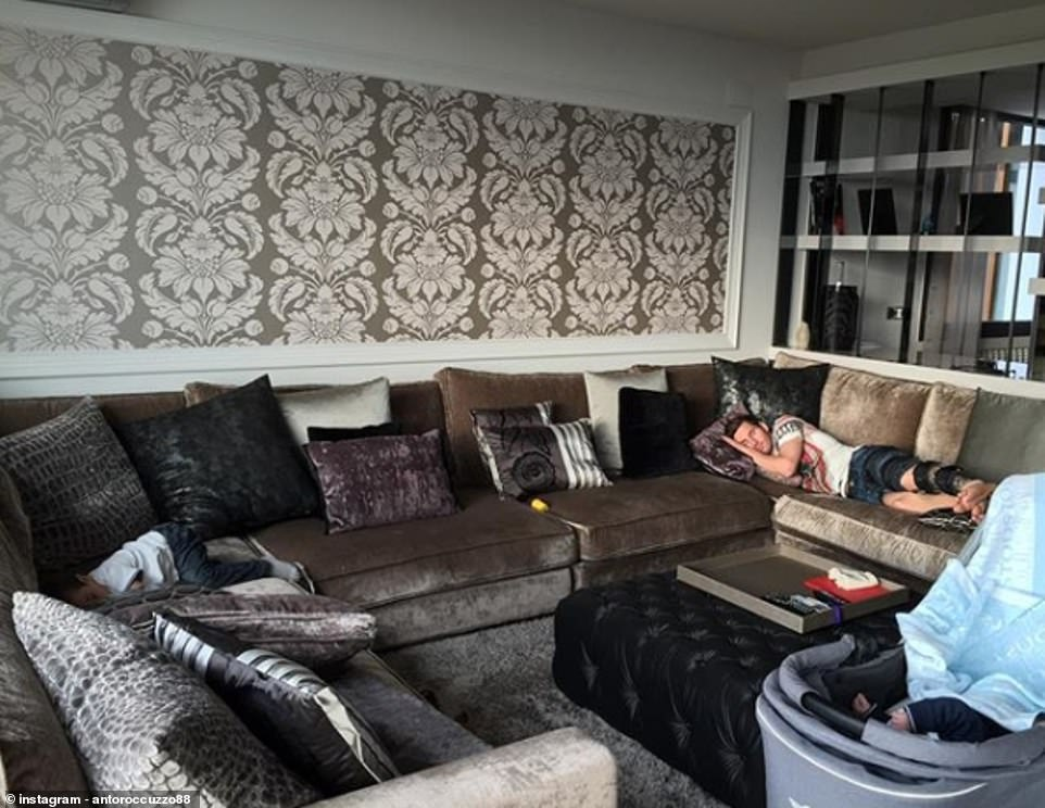Antonella shared a picture of Messi enjoying a nap on their enormous sofa, piled high with plush cushions