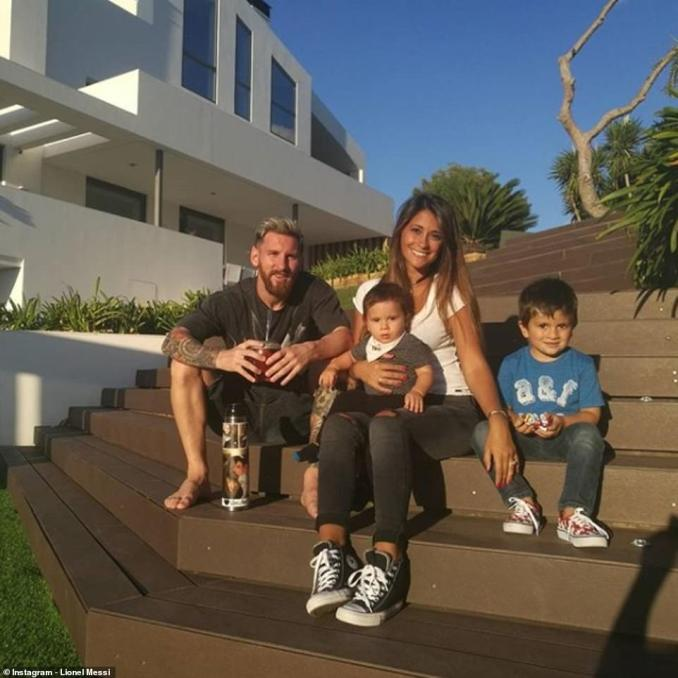 The family pose outside their beautiful home in the luxury gated community at Bellamar, on the coast south of the city