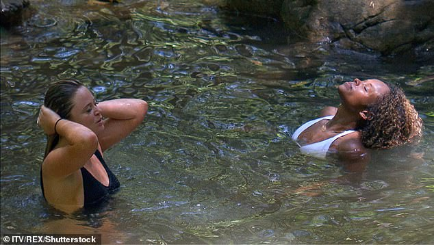 Enjoying that, girls? Emily and Fleur seemed to be in great spirits as they luxuriated in the water