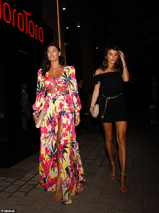 Pals: Jess was joined by a friend, who looked chic in a black bardot dress with a gold chain belt, for the glamorous meal out