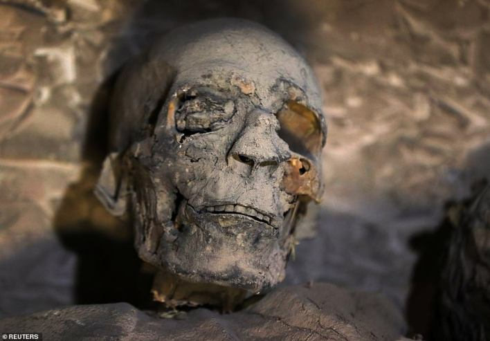 A skull is seen inside a newly discovered burial tomb at al-Assassif Necropolis, in Luxor, Egypt November 24, 2018