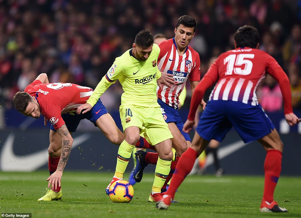 Barcelona star Lionel Messi finds himself surrounded by Atletico Madrid players during the La Liga clash