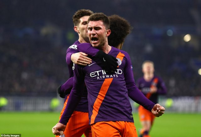 Laporte celebrates as his team-mates come over to join in following his 62nd minute equaliser in Lyon during the week