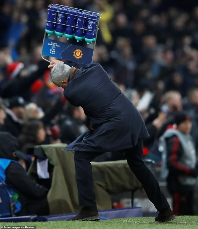 Jose Mourinho toasted the late winner by picking up a crate of bottles and throwing them to the floor in wild celebration