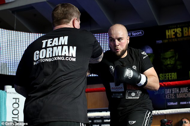 But training partner and distant cousin Nathan Gorman (R) insists Fury has learned his lessons
