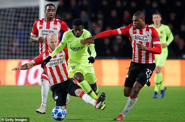 Barcelona's Ousmane Dembele takes on PSV duo Jorrit Hendrix andDenzel Dumfries