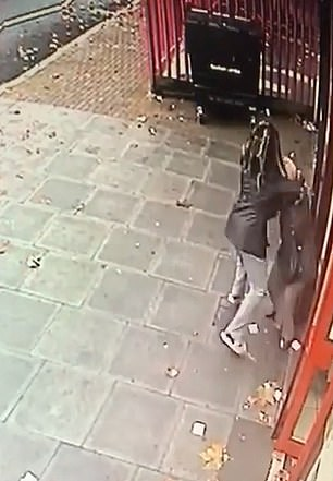 The mugger spins her around a number of times trying to take her handbag and repeatedly slapping her in the face
