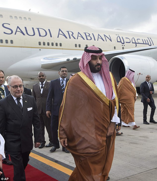 Saudi Arabia's Crown Prince Mohammed bin Salman deplanes at the airport in Buenos Aires, Argentina on Wednesday for the G20 Summit in this handout photo provided by the summit