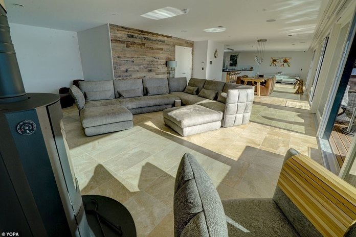 The large living area is the perfect place to entertain family and friends, sitting open plan to the dining and kitchen area