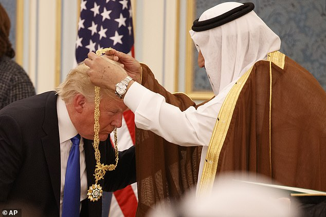 Saudi King Salman presents President Donald Trump with the highest civilian honor, the Collar of Abdulaziz Al Saud, at the Royal Court Palace, in Riyadh, Saudi Arabia, during a visit in May of 2017