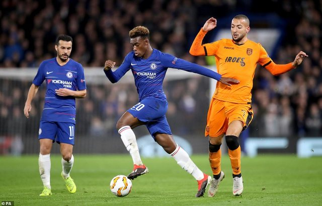 Hudson-Odoi shows a good turn of pace to escape PAOK midfielder Omar El Kaddouri during the first half