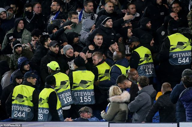 PAOK supporters clash with Stamford Bridge stewards inside the stands towards the end of Thursday evening's match