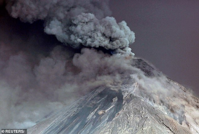 They hope this will have a similar effect to an erupting volcano releasing sulphur dioxide, which has a cooling effect (pictured: Steam rising from Fuego Volcano, Guatemala)