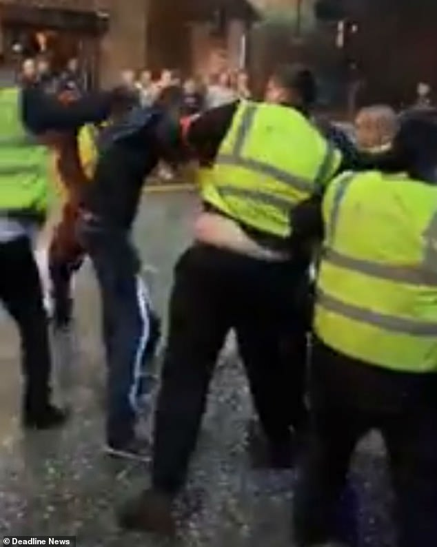 Mr. Sharratt dropping to the floor after being punched. The bouncers then surround the other man before dragging him around in the Sunday 3.20am bust-up in Manchester
