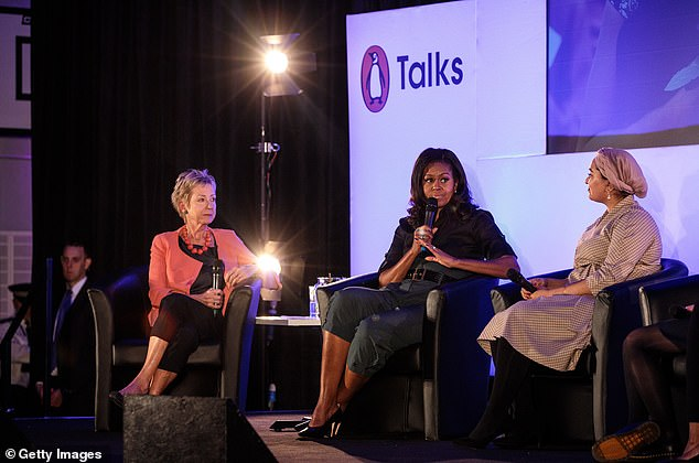 Michelle Obama speaks to Ms Dibb (left) and Ms Hassan (right) during the Penguin Talks event