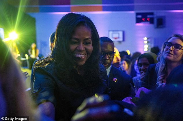 She greeted students at the all-girls secondary school as she made her way to and from the stage