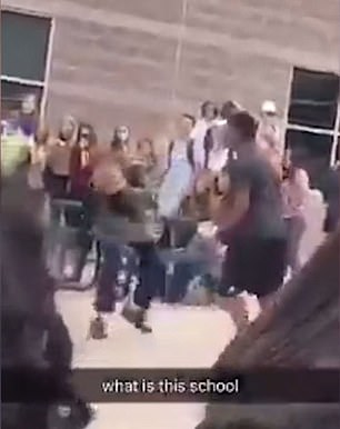 Two Mountain Vista High students duked it out in the schoolyard after one of them who was wearing Nazi regalia struck a pose symbolic of the Ku Klux Klan