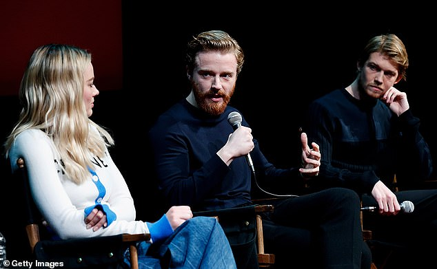 In good company: Margot took to the stage withJack Lowden(centre), who plays hersecond husband in the film, and Joe Alywn (right), who portraysQueen Elizabeth's counselor and lover