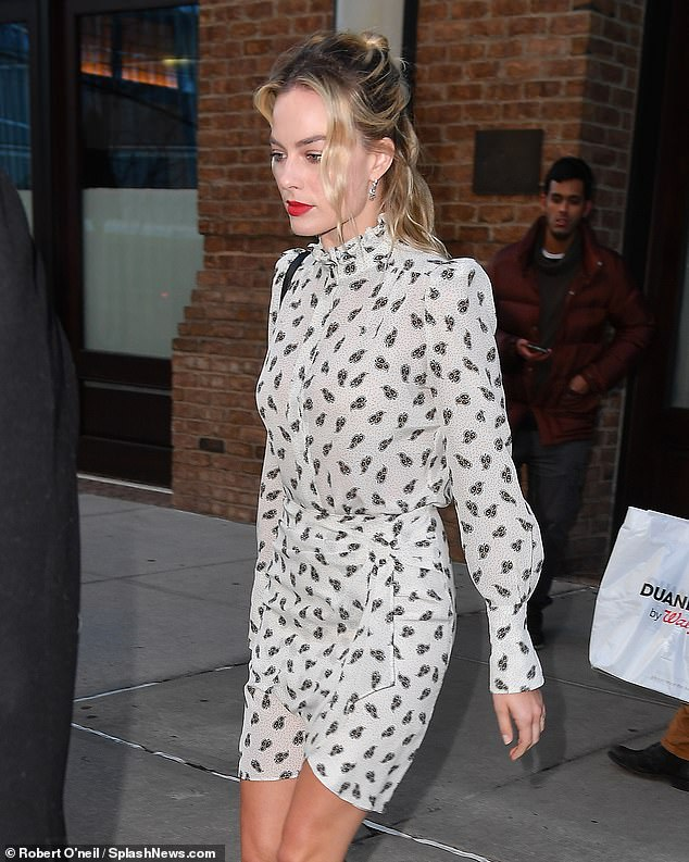 Glowing: The star showed off her flawless visage as she headed to the studios