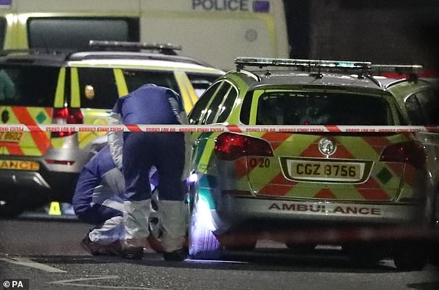 Forensic officers this evening attending the scene of a suspected shooting in West Belfast Glen Road close to St Mary's Grammar School