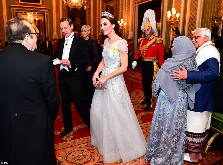 The Duchess of Cambridge put on a dazzling display in the Lover's Knot tiara as she arrived at the venue, dressed in a sparkling white gown with metallic silver detailing on the shoulders wearingthe Royal Family Order of Queen Elizabeth II
