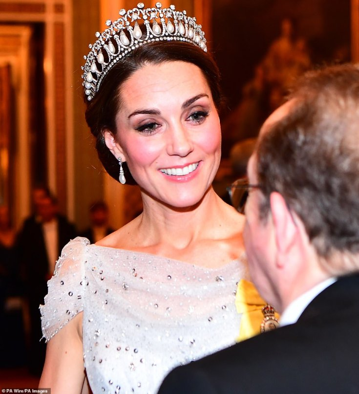 Kate Middleton teamed the tiara with a pair of pearl drop earrings, putting on a sparkling display in the dress