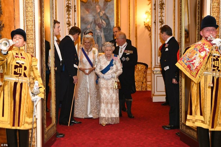 The Queen was followed by the Duke and Duchess of Cornwall and the Duke and Duchess of Cambridge, just seen, as she made her way into the lavish affair