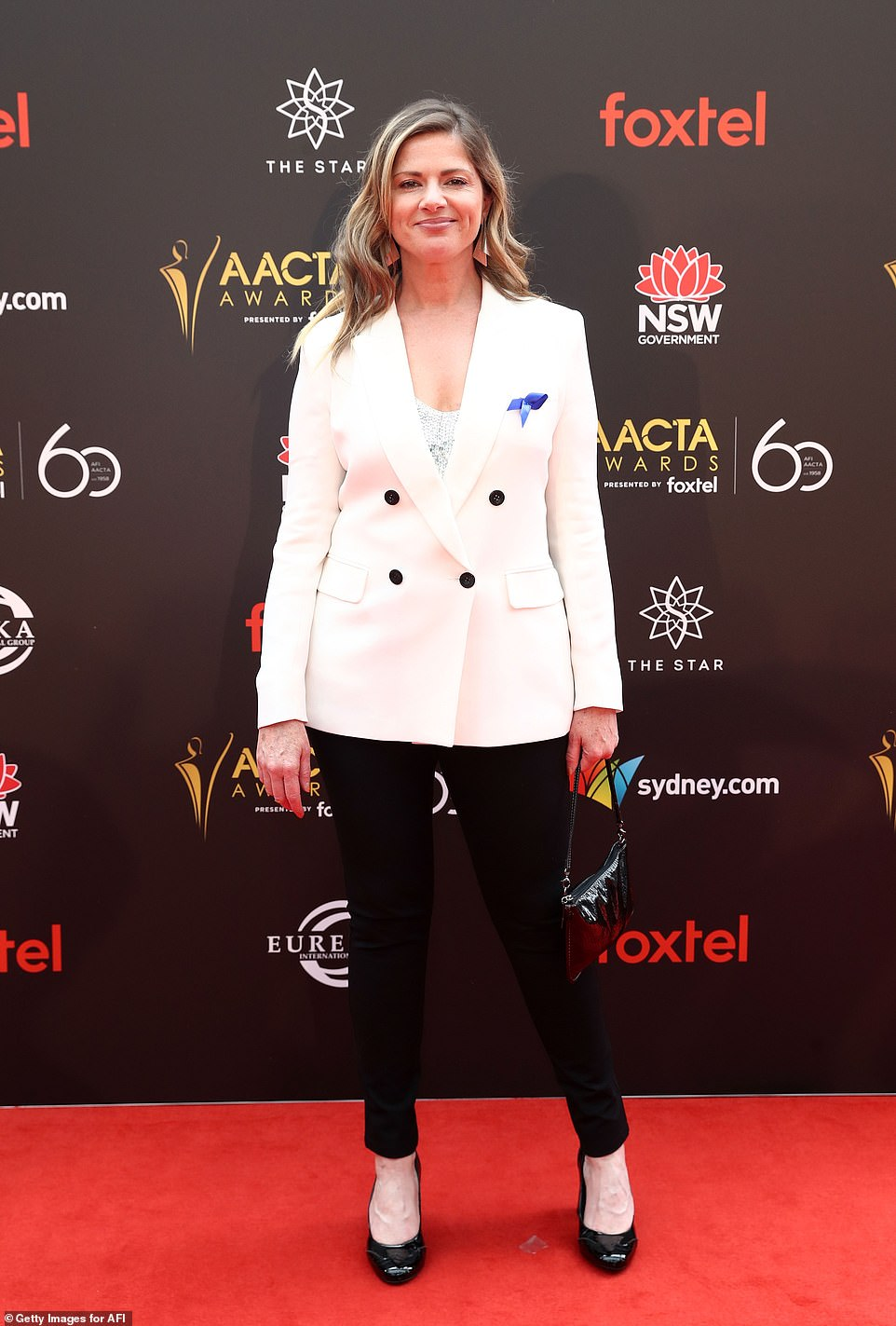 Monochrome chic! Media personality Julia Zemiro wore a white blazer paired with skinny black pants and matching pumps