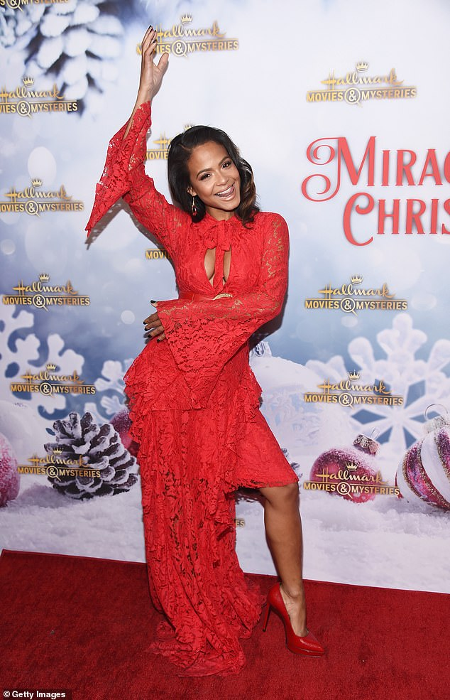 Beauty: The gorgeous entertainer hit a number of poses at the Yuletide celebration