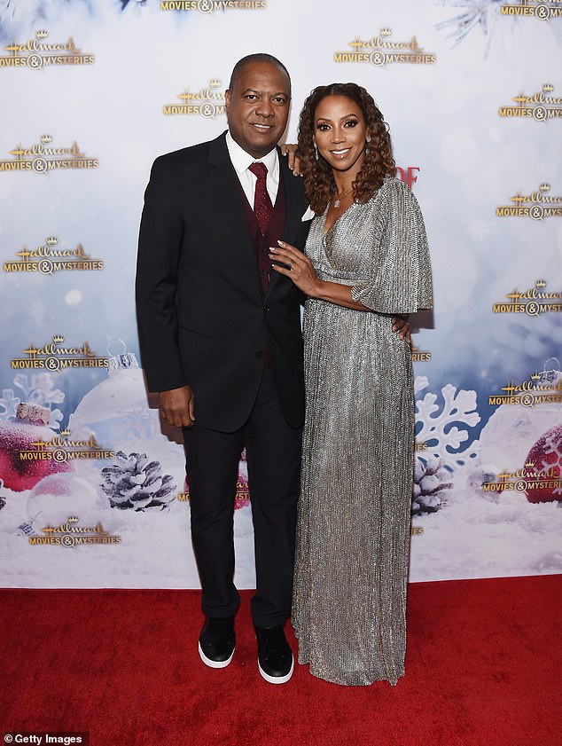 Happy: TheChicago Fire beauty posed with her husband, retired NFL quarterback Rodney Peete, on the red carpet of the event