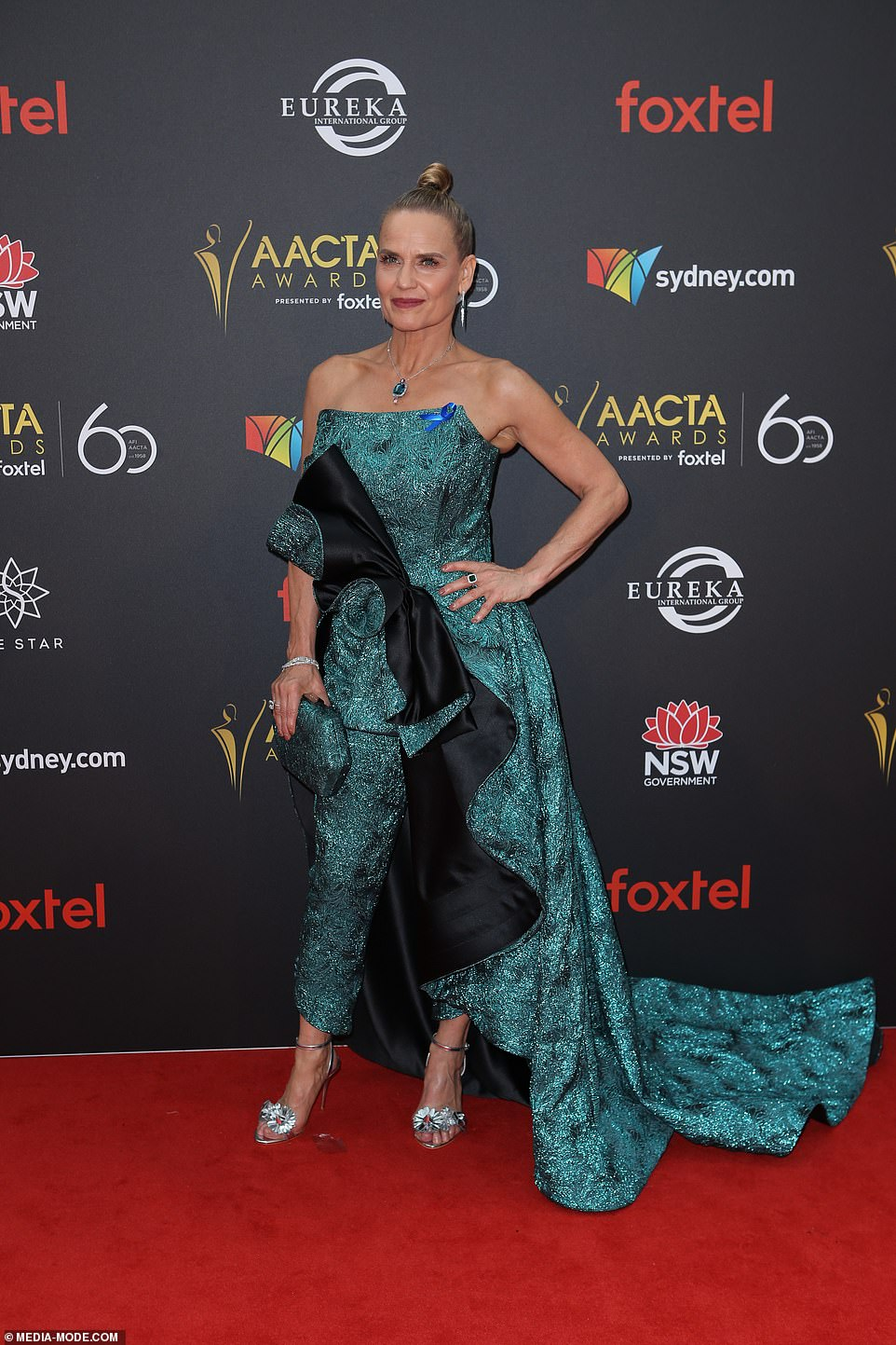 That's bold!The Block judge Shaynna Blaze, 55, stood out in a bold green gown complete with a large bow and pants