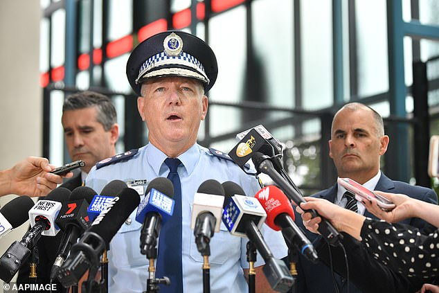 The new evidence helped police 'tie pieces of the puzzle together', New South Wales Police Commissioner Mick Fuller (pictured centre) said