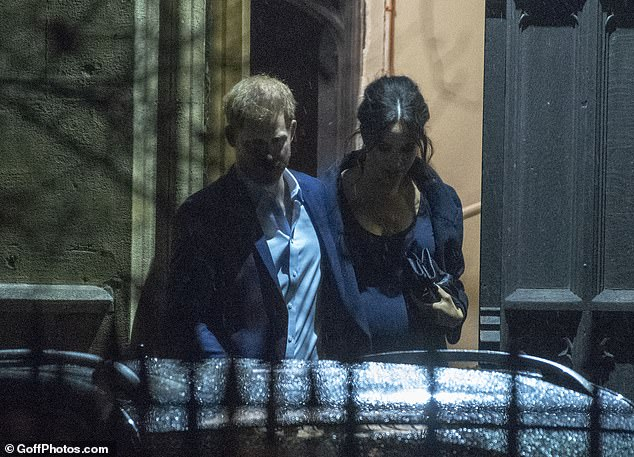 Low profile: Last night the Duchess of Sussex joined husband Prince Harry for a carol service in aid of theHenry Van Straubenzee Memorial Fund in Chelsea, London