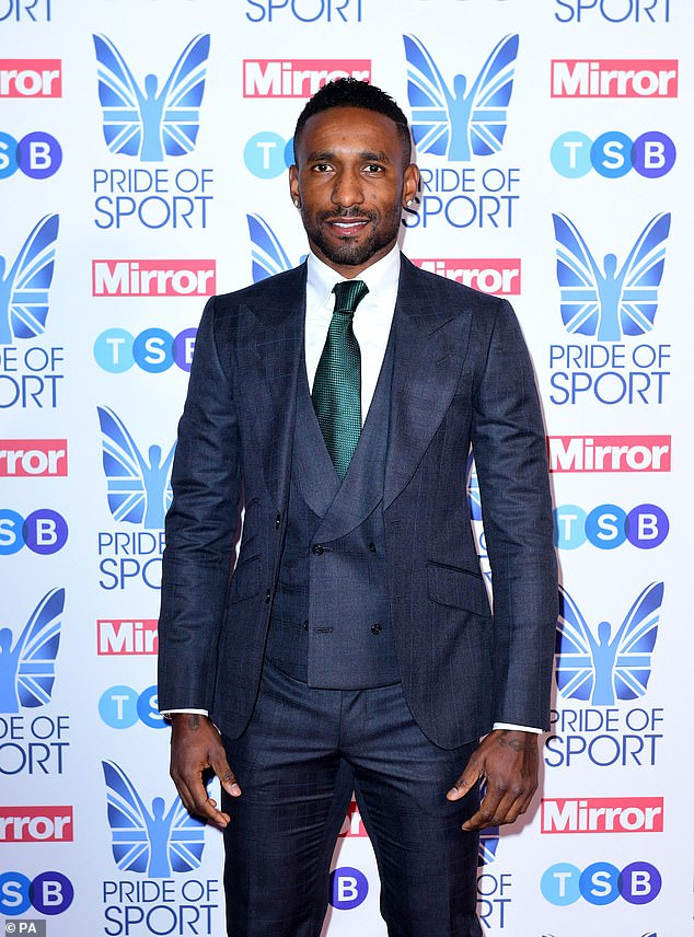The Bournemouth striker Jermain Defoe poses for the cameras before the awards ceremony