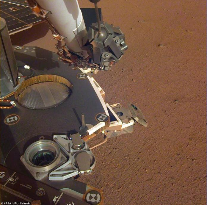 The robotic arm can extend for about six meters and will soon be used to remove the scientific instruments from the deck and put them on the ground. A partial view of the deck is shown