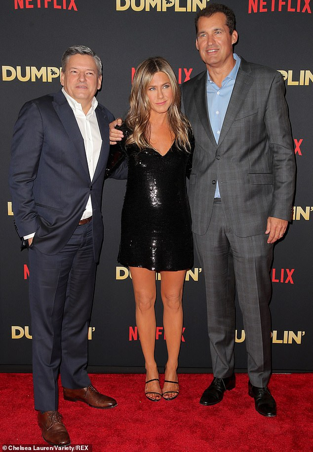 Ways to watch: Dumplin' is set for a dual release on Netflix and in theaters. Above Aniston is seen with Netflix's Ted Sarandos and Scott Stuber