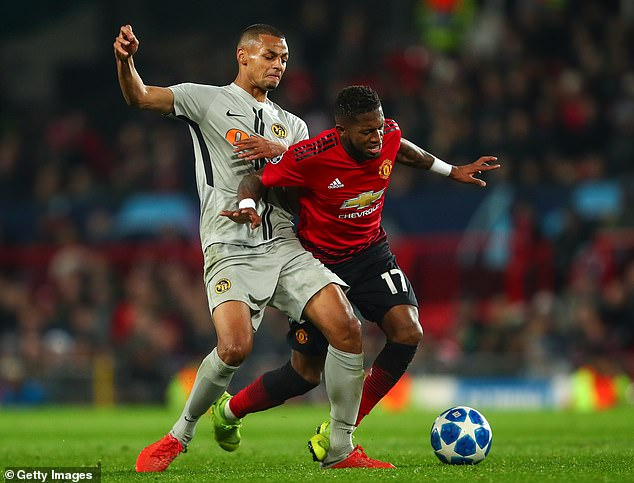The Brazilian midfielder is challenged by Djibril Sow of the Young Boys at Old Trafford last month
