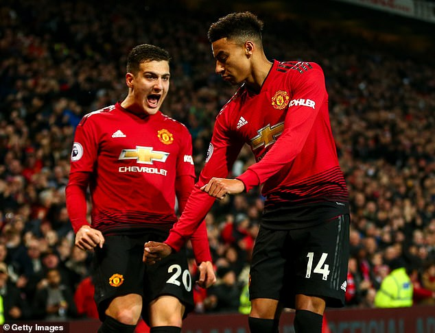 Jesse Lingard celebrates with Diogo Dalot after scoring 2-2 against Arsenal