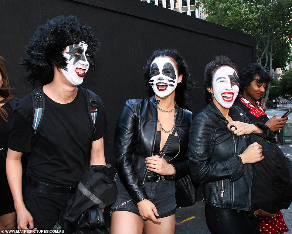 Three Sydneysiders opted for a more 'Rock n Roll' look for the evening - dressing up as KISS rock stars in black leather jackets and face paint