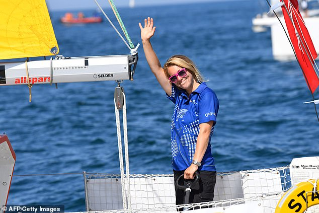 Susie Goodall waves from the helm of her boat 'DHL Starlight' as she leaves Les Sables d'Olonne Harbour on July 1, at the start of the solo around-the-world 'Golden Globe Race'