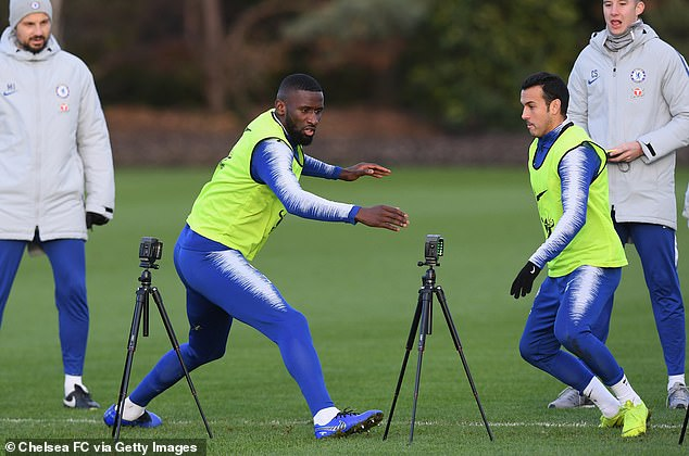 Antonio Rudiger and Pedro are fully focused as they work during the session